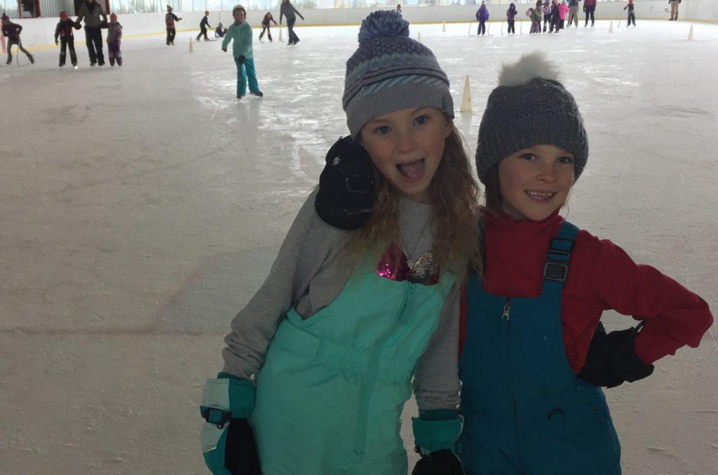 children having fun ice skating